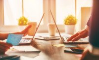 man and woman working on their computers.